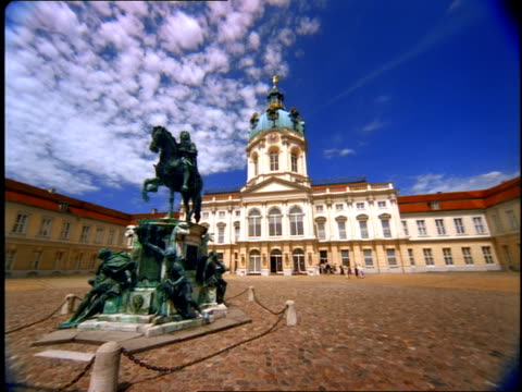 a statue of a man on a horse stands before the charlottenburg palace in berlin. - charlottenburg palace stock videos & royalty-free footage