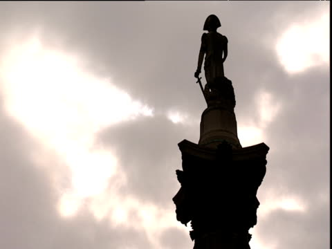 statue of admiral nelson atop nelson's column against dramatic sky london - nelson's column stock videos & royalty-free footage
