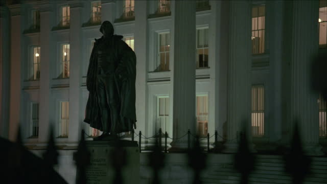 ws statue of alexander hamilton silhouetted in front of us treasury building / washington, d.c., united states - alexander hamilton politician stock videos and b-roll footage