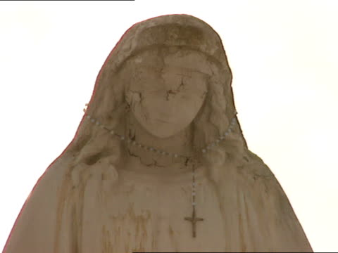 statue of blessed virgin mary w/ rosary placed around neck . - worry beads stock videos & royalty-free footage
