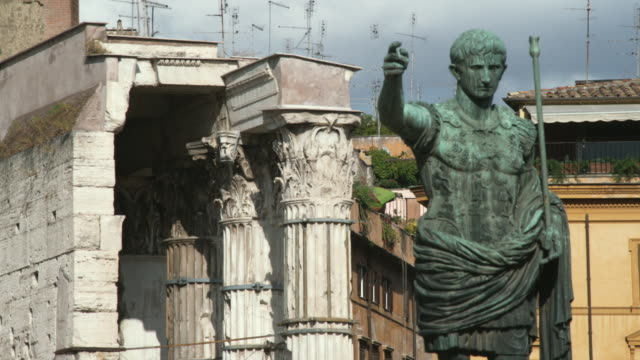 MS Statue of Caesar with buildings behind / Rome, Italy