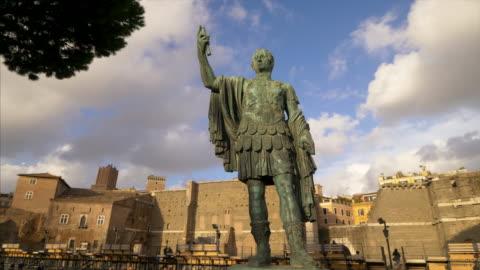 statue of emperor julius caesar along via dei fori imperiali at the roman forum in rome, italy - rome italy stock videos & royalty-free footage