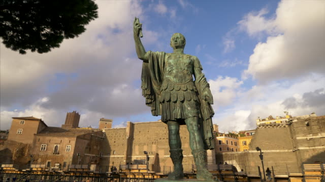 statue of emperor julius caesar along via dei fori imperiali at the roman forum in rome, italy - old ruin stock videos & royalty-free footage