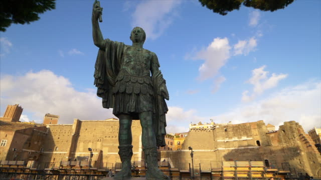 statue of emperor julius caesar along via dei fori imperiali at the roman forum in rome, italy - statue stock videos & royalty-free footage