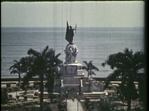 1958 MS TU WS MONTAGE Statue of explorer Balboa by seaside, tower and old ruins / Panama City, Panama / AUDIO