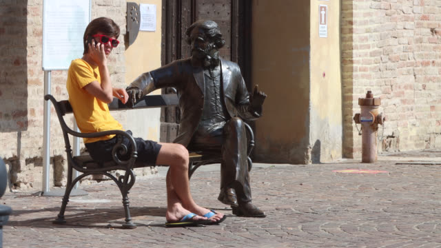 statue of giuseppe verdi on a bench - one teenage boy only stock videos & royalty-free footage