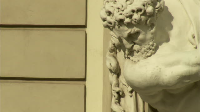 A statue of Hercules stands outside the Hofburg Palace in Vienna. Available in HD.