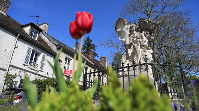 statue of jean jacques rousseau, with tulips in the foreground near the jean jacques rousseau park on a sunny spring day on april 22, 2021 in... - daydreaming stock videos & royalty-free footage