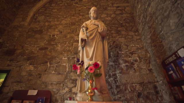 statue of jesus christ in ancient church - ireland - male likeness stock videos & royalty-free footage