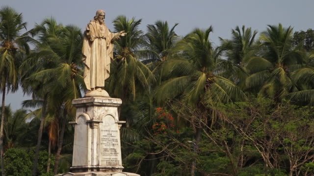 A statue of Jesus stands tall in rural India