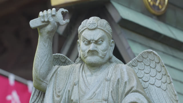 Statue of Karasu tengu outside Takao-san Yakuo-in Yuki-ji on Mount Takao, Japan.