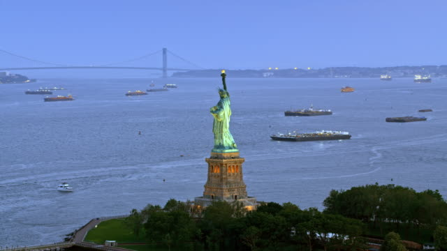 AERIAL Statue of Liberty at dusk