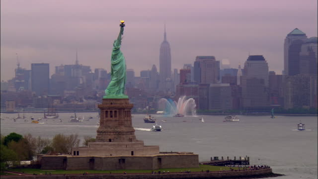 ms, pan, statue of liberty, city skyline in background, new york city, new york, usa - 2006 stock videos & royalty-free footage