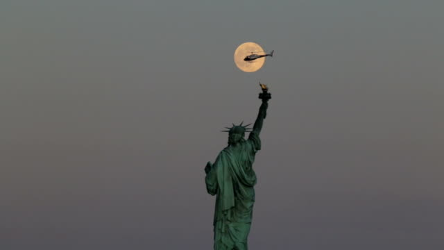 statue of liberty, full moon and a helicopter - helicopter tour stock videos and b-roll footage