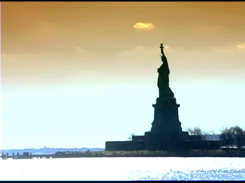 statue of liberty in new york city at dusk - female likeness stock videos & royalty-free footage