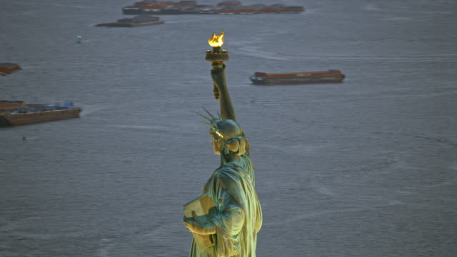 aerial statue of liberty in new york harbor in the evening - statue of liberty new york city stock videos & royalty-free footage