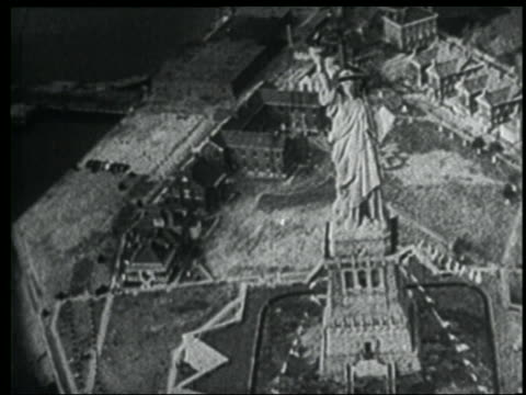 b/w 1939 newsreel aerial statue of liberty + liberty island / nyc - statue of liberty new york city stock videos & royalty-free footage