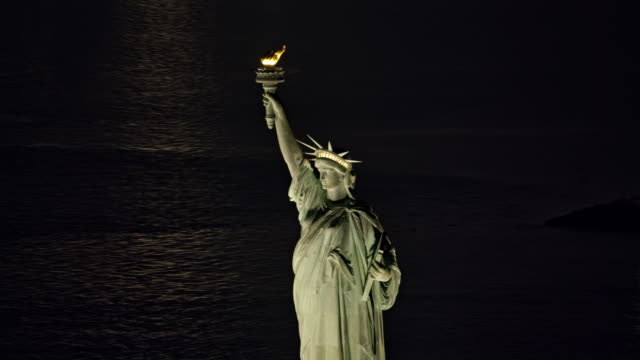 aerial statue of liberty lit by lights at night - statue of liberty new york city stock videos & royalty-free footage