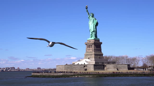 statue of liberty - new york city, new york, shot from ferry approaching to liberty island. nyc landmark tourism concept. - statue of liberty new york city stock videos & royalty-free footage