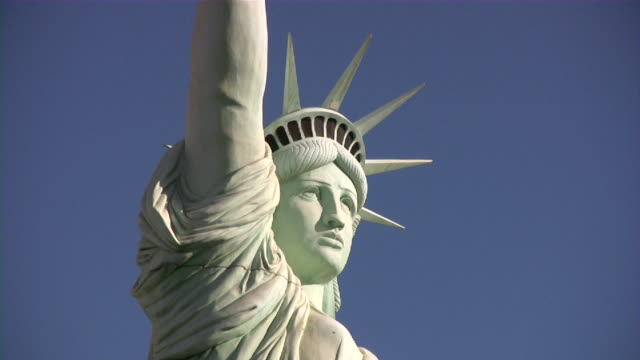 statue of liberty on a blue sky - statue of liberty stock videos & royalty-free footage