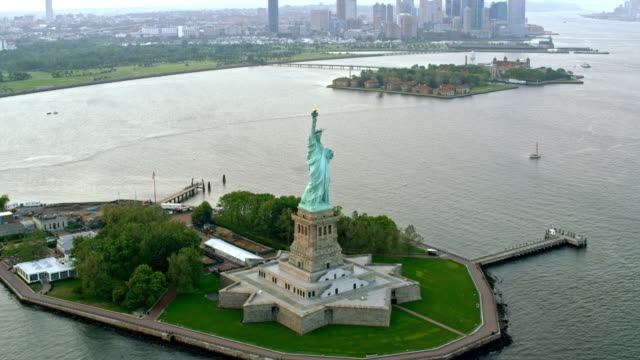 aerial statue of liberty on liberty island, ny - statue of liberty new york city stock videos & royalty-free footage