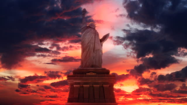statue of liberty sun set - patriotism stock videos & royalty-free footage