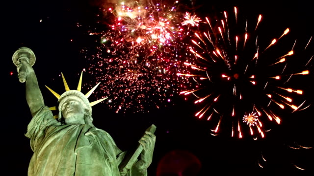 statue of liberty with fireworks behind (new york) - statue of liberty stock videos and b-roll footage