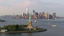 AERIAL Statue of Liberty with the Freedom Tower in the background