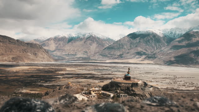 statue of maitreya buddha at diskit monastery nubra valley leh ladakh with himalaya - monastery stock videos & royalty-free footage
