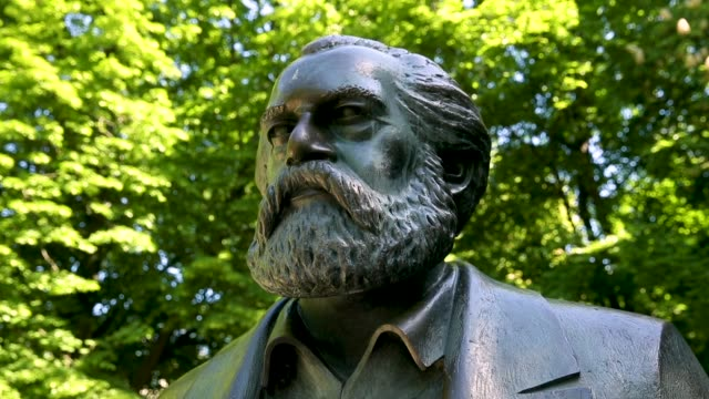 a statue of philosopher and revolutionary karl marx stands in a public park on may 4 2018 in berlin germany the german city of trier marx's... - philosopher stock videos & royalty-free footage