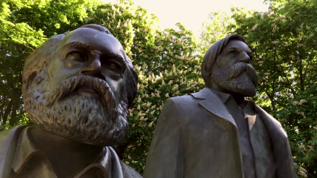 a statue of philosophers karl marx and friedrich engels stands in a public park on may 4 2018 in berlin germany the german city of trier marx's... - socialism stock videos & royalty-free footage