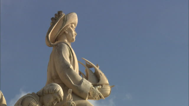 statue of prince henry the navigator at the monument to the discoveries in lisbon, portugal - portuguese culture stock videos & royalty-free footage
