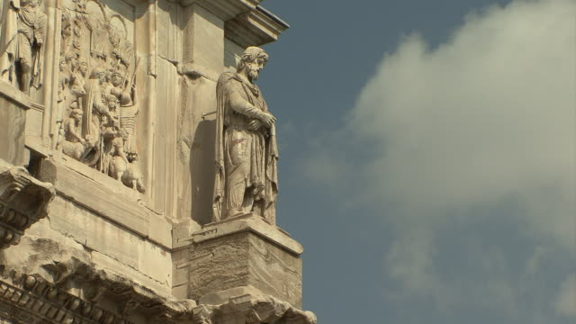 ms statue of prisoner on column on arch of constantine / rome, italy  - arch of constantine stock videos and b-roll footage