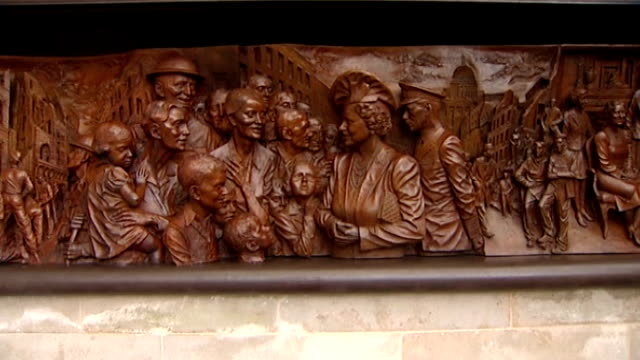 Statue of Queen Mother unveiled on the Mall Bronze frieze showing Queen Mother and King George VI meeting people of East End
