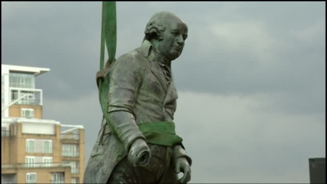 statue of robert milligan in the london docklands removed by the council as he was a slave trader - removing stock videos & royalty-free footage