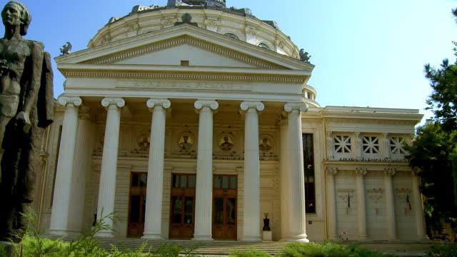 ms pan statue of romanian poet mihai eminescu in front of   romanian athenaeum/ bucharest, romania - romania stock videos & royalty-free footage