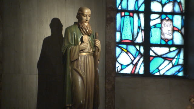 CU, ZO, WS, Statue of saints and candles in church, Manhattan Beach, California, USA