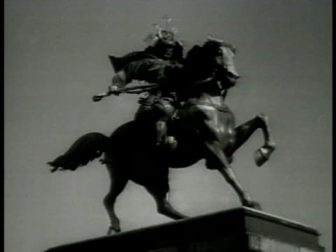statue of samurai on horseback japanese officers bowing toward imperial palace emperor hirohito riding white horse w/ escort saluting soldiers rising... - recreational horseback riding stock videos and b-roll footage