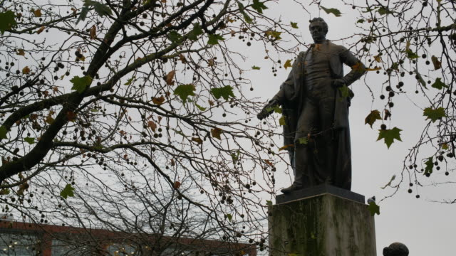 a statue of sir robert peel, former uk prime minister, stands against a grey sky - politics stock videos & royalty-free footage