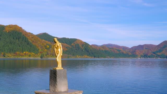 ws statue of tatsuko, lake tazawa, semboku, akita prefecture, japan - 秋田県点の映像素材/bロール