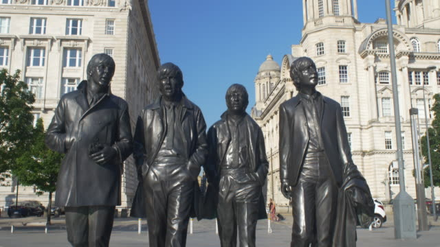 statue of the beatles on the liverpool waterfront. tilt-up. - liverpool england stock videos & royalty-free footage