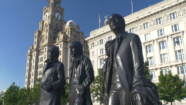 statue of the beatles on the liverpool waterfront.tilt-up. - the beatles stock videos & royalty-free footage