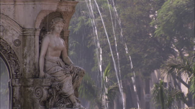 a statue of the goddess flora decorates a fountain in mumbai. available in hd. - fountain stock videos & royalty-free footage