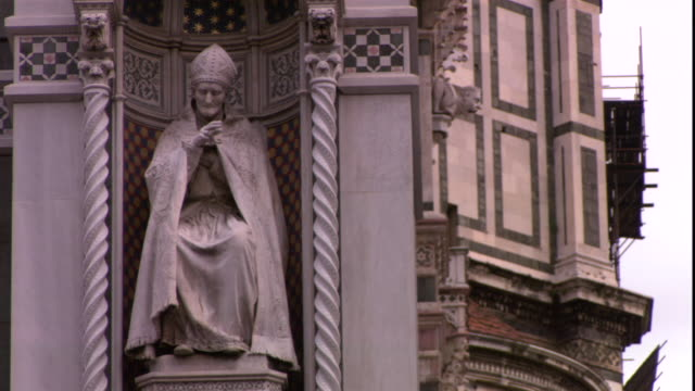 a statue of the pope occupies an ornate niche in spain. - clergy stock videos & royalty-free footage