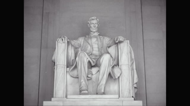 MS PAN Statue of U.S. President Abraham Lincoln with memorial plaque at Lincoln Memorial / Washington DC, United States