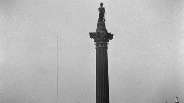 a statue of vice admiral horatio nelson tops the nelson monument in london's trafalgar square. - 1936 stock videos & royalty-free footage