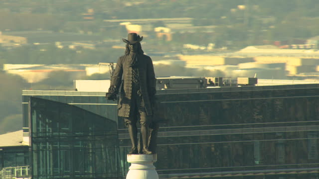cu aerial zo statue of william penn atop city hall with surrounding buildings / philadelphia, pennsylvania, united states - william penn stock videos and b-roll footage