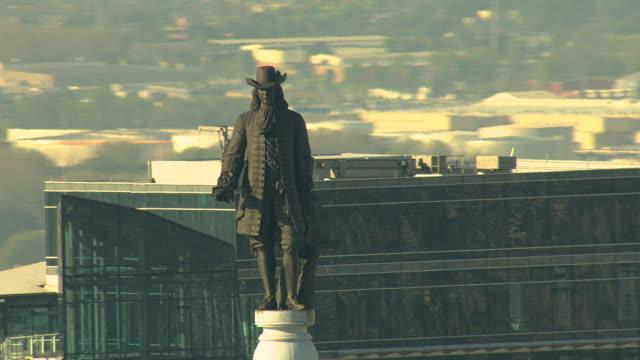 CU AERIAL ZO Statue of William Penn atop City Hall with surrounding buildings / Philadelphia, Pennsylvania, United States
