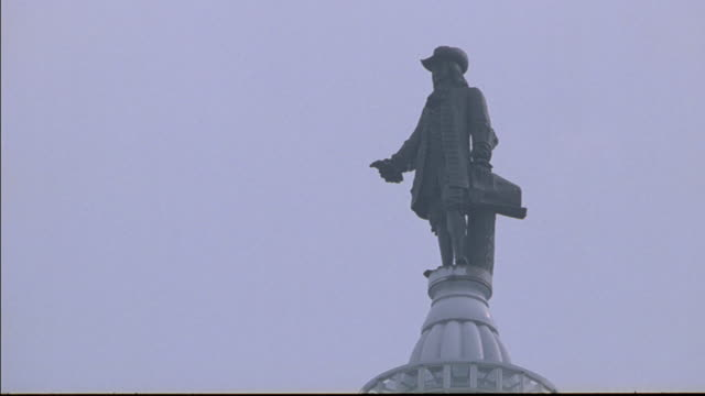 a statue of william penn sits atop a dome. - william penn stock videos & royalty-free footage