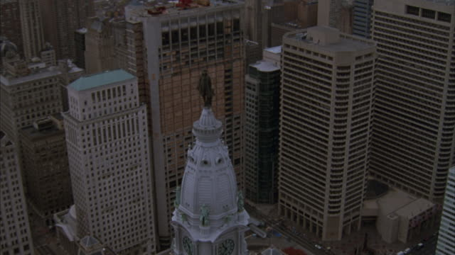 A statue of William Penn sits on top of city hall in Philadelphia, Pennsylvania.